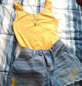 Bright yellow bodysuit